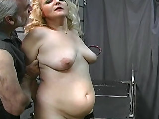 Abused ass of fat mature in his dungeon