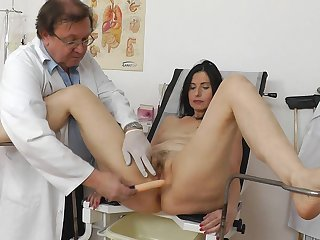 Little bit chubby long-haired brunette Nadezda gets naked and fucks on medical chair so freaking hot