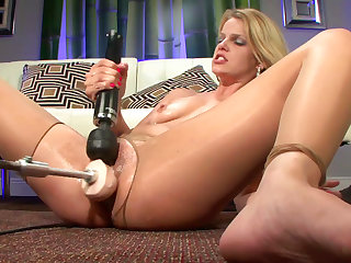 Slutty big tit blonde with accurate trimmed puss is getting banged by a fucking machine