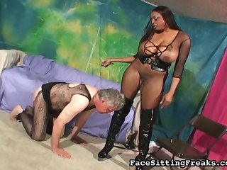 Milf with dark skin and big boobies is humiliating this old slave with dildo