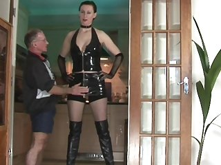 Cute giant Lara Latex poses with naked boobies on her leather boots in front that hardcore grandpa