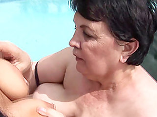 Cute granny lesbian licking pussy seductively outdoor