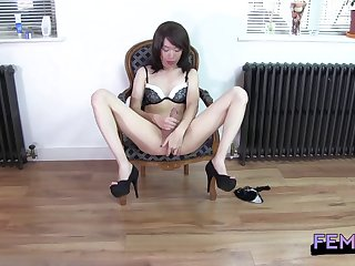 Tranny playing in black fishnet pantyhose and jerking off