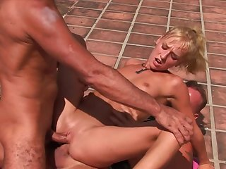 Sporty girl double penetrated outdoors by two dudes