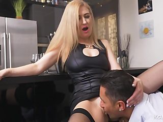 Slut in a leather dress sucks dick and gets fucked