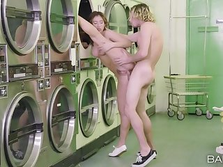Banging a cute teen in pigtails in the laundromat