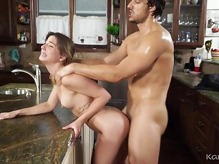 Sweaty sex in the kitchen with a petite pornstar slut