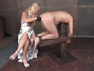 Bound sub guy fingered anally by his gloved mistress