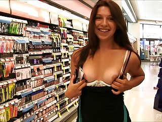 Pretty girl has such fun flashing her small tits in public