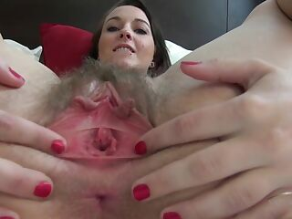 ATKGirlfriends video: Ashley Stone puts her fingers inside her hairy pussy.