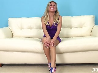 Skintight purple dress looks good on the sexy solo babe