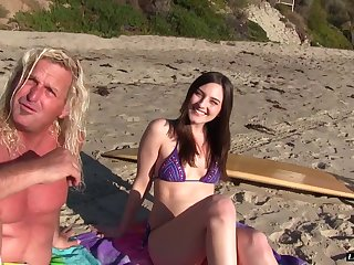 Dirty surfer girl hits the waves then hits his hard cock
